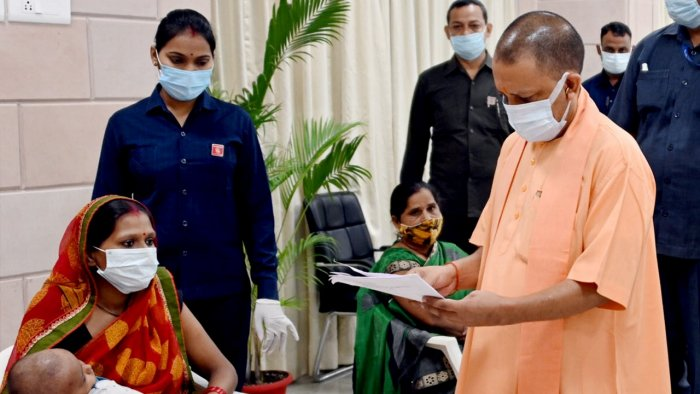 UP Chief Minister Yogi Adityanath during 'Janta Darshan' organised at his official residence in Lucknow. Credit: PTI Photo