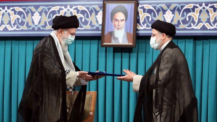 Iran's new President Ebrahim Raisi receives the endorsement decree for his presidency from Iran's Supreme Leader Ayatollah Ali Khamenei. Credit: Reuters Photo