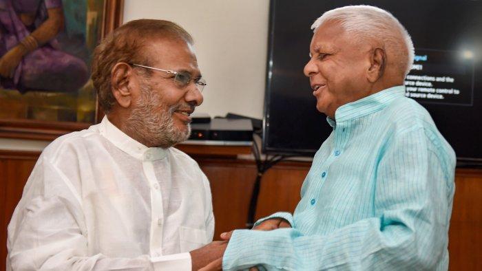 Rashtriya Janata Dal supremo Lalu Prasad Yadav meets former JD(U) leader Sharad Yadav in New Delhi. Credit: PTI File Photo