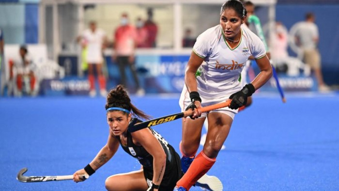 India's Gurjit Kaur (R) carries the ball past Argentina's Maria Jose Granatto during their women's semi-final match of the Tokyo 2020 Olympic Games field hockey competition. Credit: AFP Photo