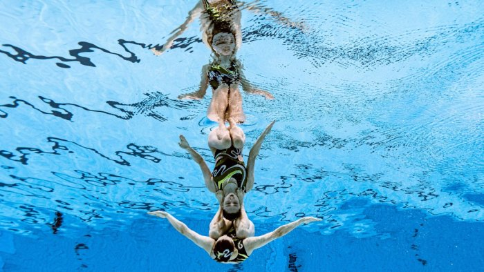 The final of the women's duet free routine artistic swimming event. Credit: AFP Photo