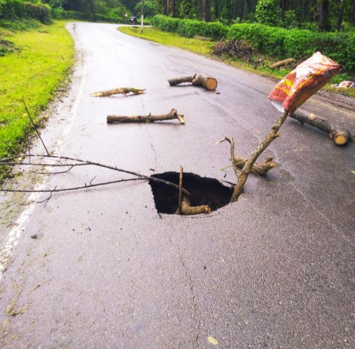 Part of a road on the Suntikoppa state highway caved in following heavy rain.