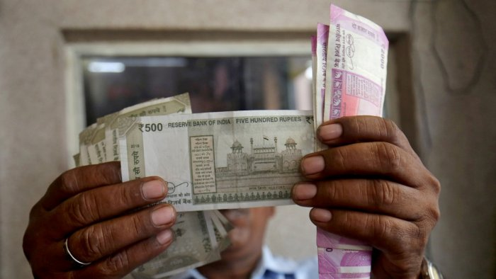 At the interbank foreign exchange, the domestic unit opened at 74.11 against the dollar. Credit: Reuters Photo