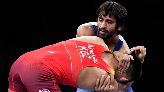 Ernazar Akmataliev of Kyrgyzstan in action against Bajrang of India. Credit: Reuters Photo