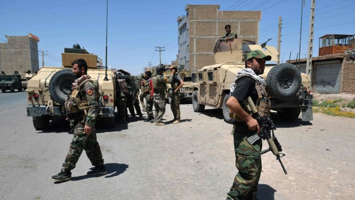 Afghan National Army commando forces walk along a road amid ongoing fighting between Taliban and Afghan security forces inAfghan National Army commando forces walk along a road amid ongoing fighting between Taliban and Afghan security forces in Herat. Credit: AFP Photo