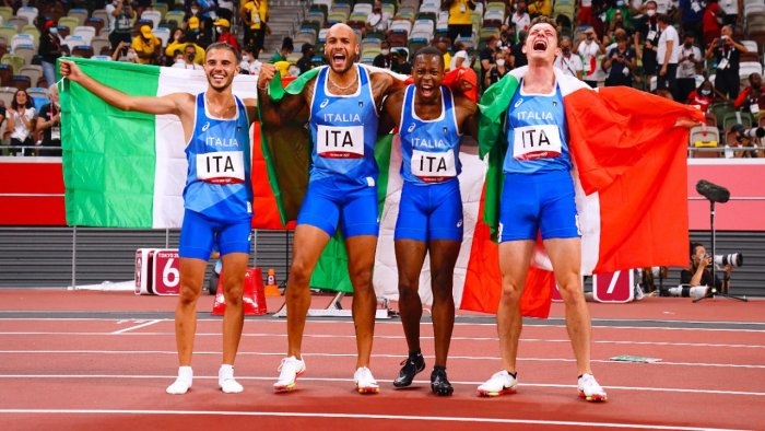 (L to R) Italians Lorenzo Patta, Lamont Marcell Jacobs, Eseosa Desalu and Filippo Tortu celebrate their 4x100m relay win. Credit: AFP Photo