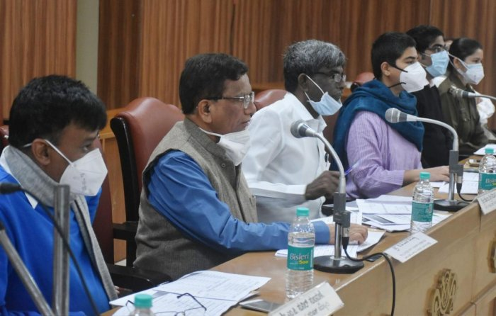 District In-charge Minister Kota Srinivas Poojary chairs a progress review meeting at the Zilla Panchayat auditorium in Madikeri on Friday.