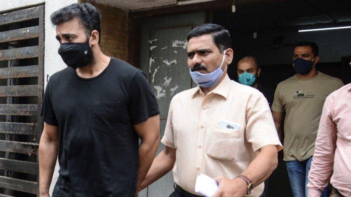 Mumbai Police's Crime Branch team escort Raj Kundra (L). Credit: AFP Photo