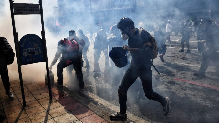 The 500 or so protesters were vastly outnumbered by police, who said Friday they planned to deploy nearly 6,000 officers to tackle the rally. Credit: AFP Photo