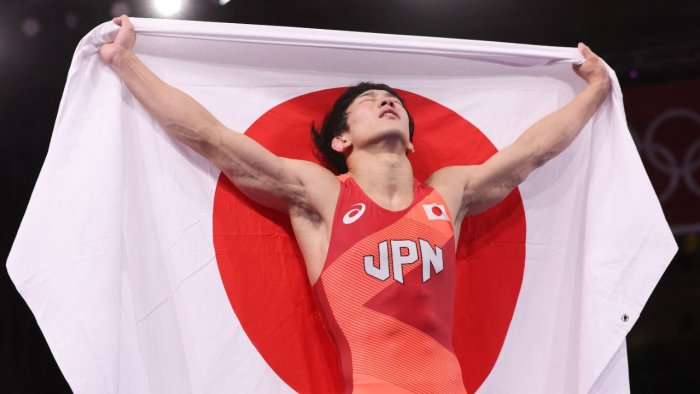 Japan's Takuto Otoguro celebrates his gold medal victory against Azerbaijan's Haji Aliyev. Credit: AFP Photo