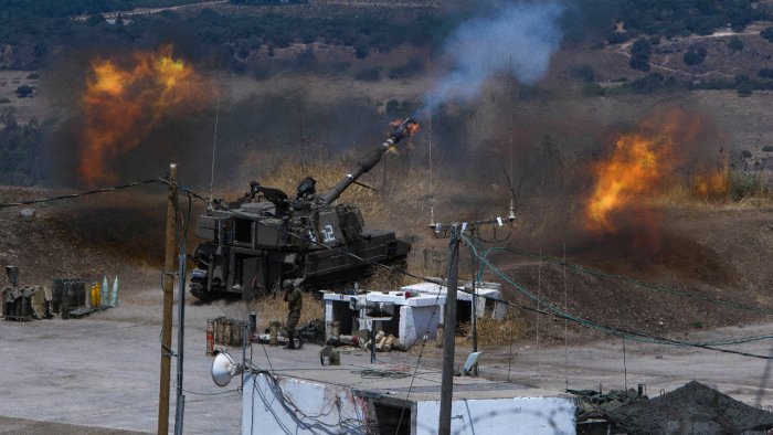 Israeli forces fire artillery from their position on the border with Lebanon after a barrage of rockets were fired from Lebanon. Creidt: AP Photo