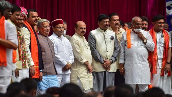 Karnataka Governor Thawar Chand Gehlot and Chief Minister Basavaraj Bommai with newly inducted ministers during swearing-in ceremony to form the Cabinet at Raj Bhavan in Bengaluru. Credit: PTI Photo