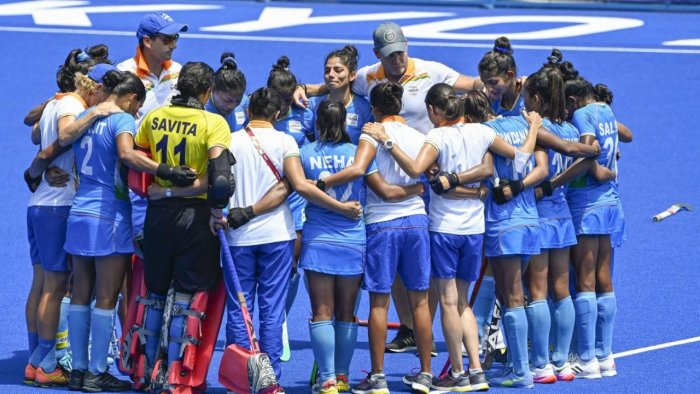 Indian players huddle after losing their women's field hockey bronze medal match against Great Britain, at the 2020 Summer Olympics, in Tokyo. Credit: PTI Photo