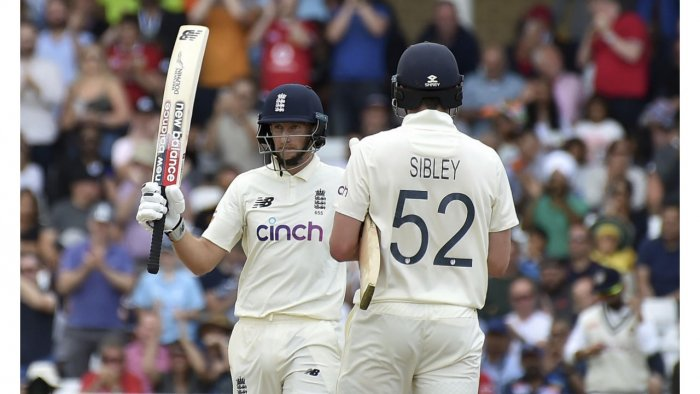 England captain Joe Root, left, raises his bat to celebrate scoring fifty runs during the fourth day of first test cricket match between England and India, at Trent Bridge in Nottingham. Credit: AP/PTI Photo