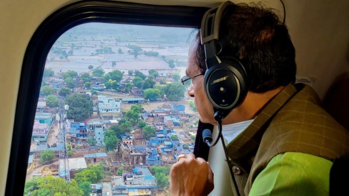 Madhya Pradesh Chief Minister Shivraj Singh Chouhan conducts aerial survey of flood-affected areas of the state, in Datia district, Wednesday. Credit: PTI Photo
