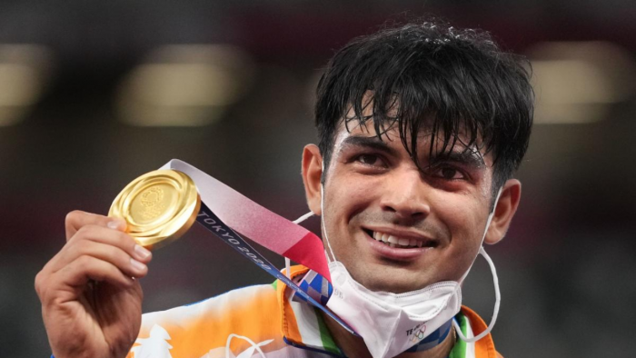 India's Neeraj Chopra holds the gold medal after winning in the final of the men's javelin throw event at the 2020 Summer Olympics. Credit: PTI Photo