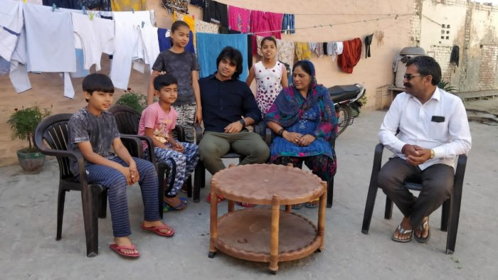 Neeraj Chopra with his family in Khandra. Credit: Special Arrangement