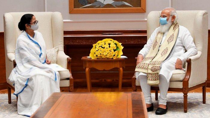 Narendra Modi with West Bengal CM Mamata Banerjee during their meeting in New Delhi. Credit: PTI File Photo