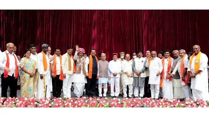 Karnataka Governor Thawar Chand Gehlot and Chief Minister Basavaraj Bommai with newly inducted ministers during swearing-in ceremony. Credit: PTI Photo