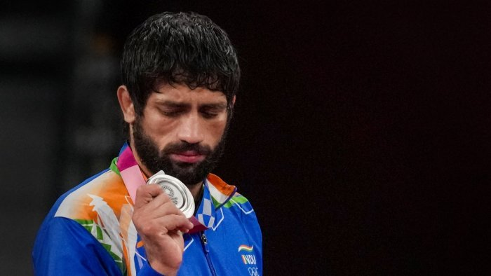 Dahiya holds his Olympic silver medal. Credit: PTI Photo