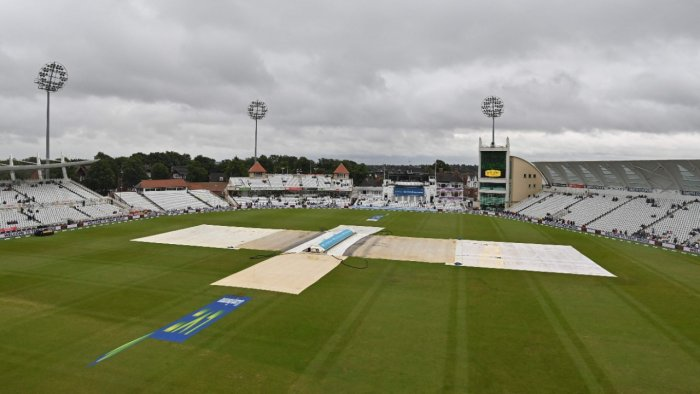 The covers remain on the pitch as rain delays the start of play on the day 5 of the first England-India Test at Trent Bridge cricket ground in Nottingham. Credit: AFP Photo
