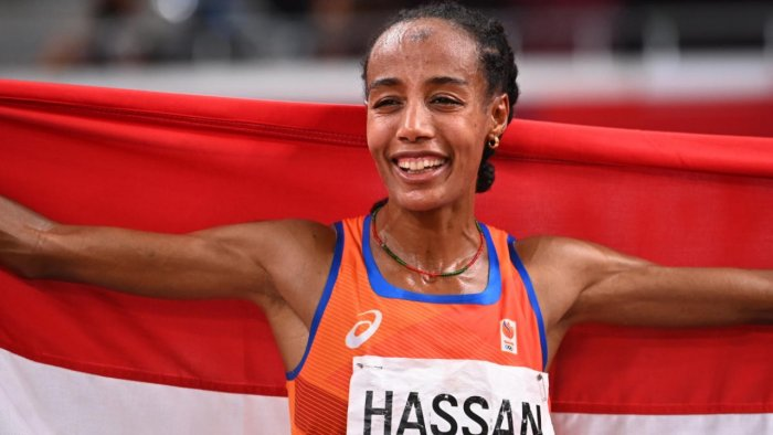 Sifan Hassan of the Netherlands celebrates with her national flag after winning gold. Credit: Reuters Photo