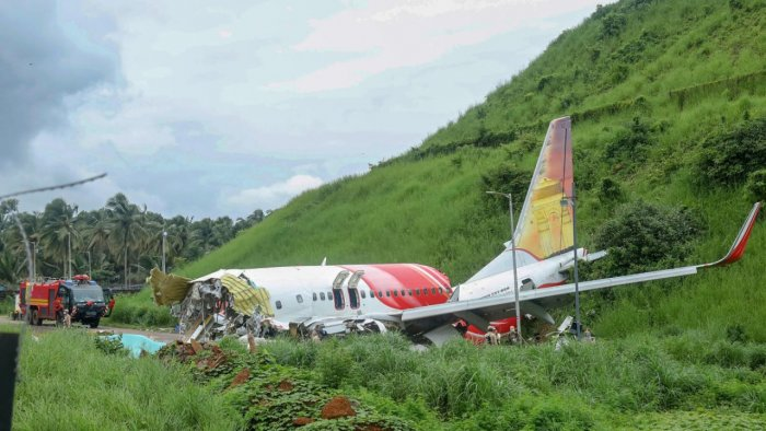 Mangled remains of an Air India Express flight, en route from Dubai, after it skidded off the runway while landing on Friday night, at Karippur in Kozhikode. Credit: PTI Photo