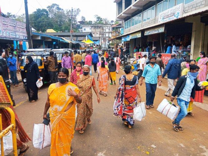 People throng various shops in Suntikoppa on Sunday.