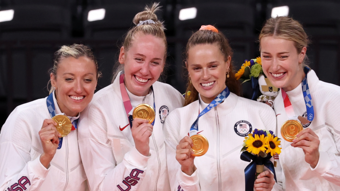 Team members of the United States pose with their gold medals in women's volleyball. Credit: Reuters Photo
