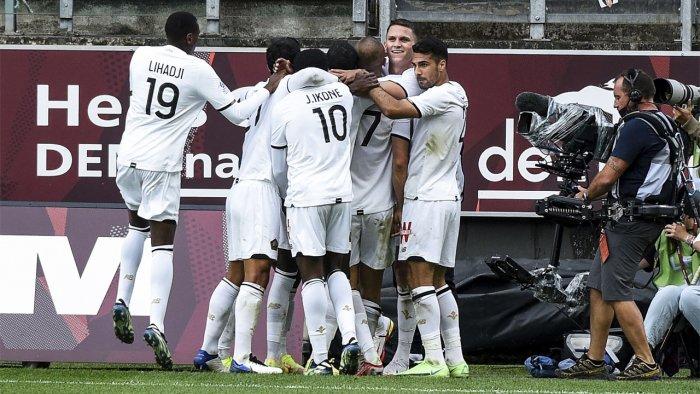 Lille's Turkish forward Burak Yilmaz (C) celebrates with teammates after scoring his team's third goal. Credit: AFP Photo