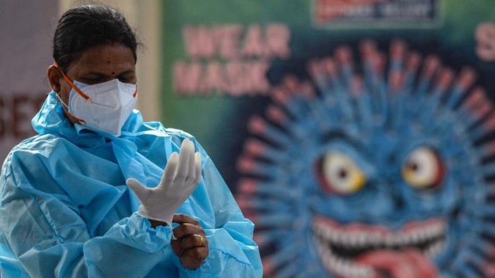 Health workers wear personal protective equipment (PPE) as they prepare to perform Covid-19 coronavirus screening at a railway station in Chennai on August 5, 2021. Credit: AFP Photo