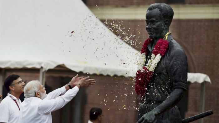 Modi pays floral tribute to Major Dhyan Chand. Credit: PTI Photo