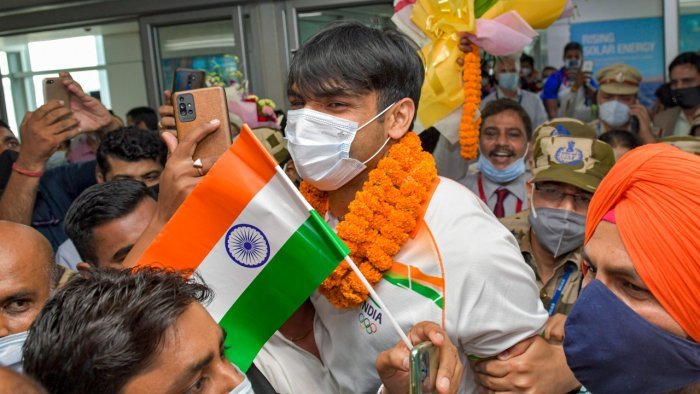 Olympic gold medalist Neeraj Chopra being welcomed on his arrival at IGI Airport, New Delhi. Credit: PTI Photo