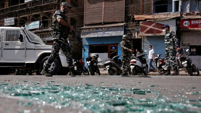 CRPF personnel examine the site of a grenade explosion in Srinagar. Credit: Reuters Photo