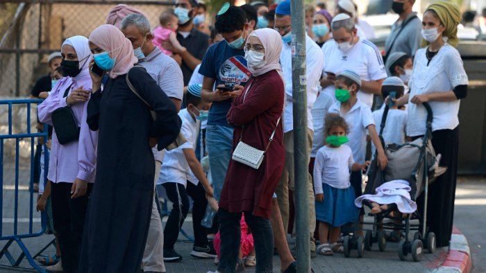 Muslims and Jews wait outside Israel's Magen David Adom medical service for a rapid Covid-19 antigenic test in Jerusalem. Credit: AFP Photo