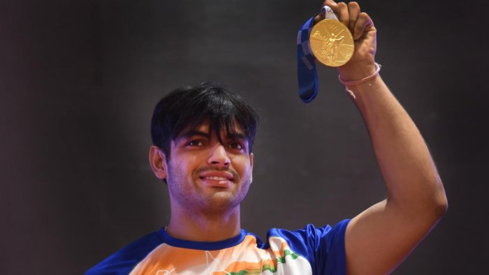 Neeraj Chopra, who won gold medal in the javelin throw event of the recently concluded Tokyo Olympics 2020, shows his medal at a press conference in New Delhi. Credit: PTI Photo