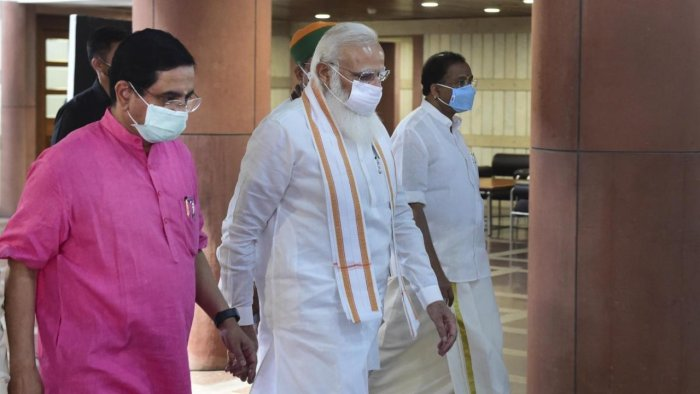 Prime Minister Narendra Modi with Parliamentary Affairs Minister Pralhad Joshi arrives for the BJP Parliamentary Party meeting, during the Monsoon Session of Parliament, in New Delhi, Tuesday, August 10, 2021. Credit: PTI Photo