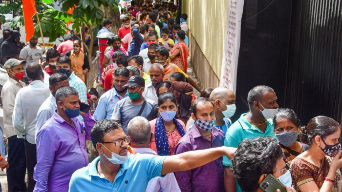 Beneficiaries wait to receive a dose of COVID-19 vaccine during mass vaccination drive organised by Shiv Sena in association with Reliance hospital, in Mumbai. Credit: PTI Photo
