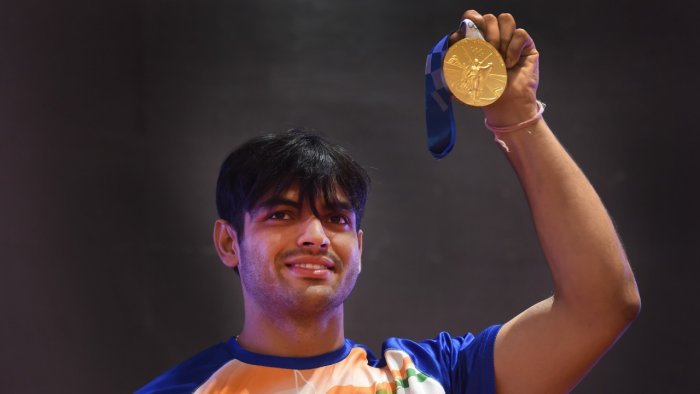 Javelin thrower Neeraj Chopra poses with his Olympic gold medal. Credit: PTI Photo