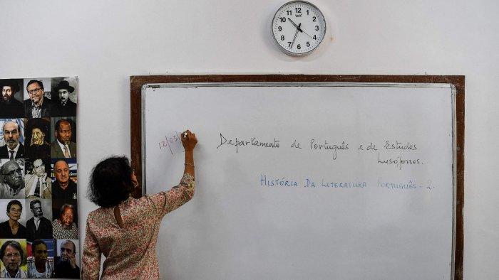 Lorraine Alberto conducting her Portuguese class. Credit: AFP Photo