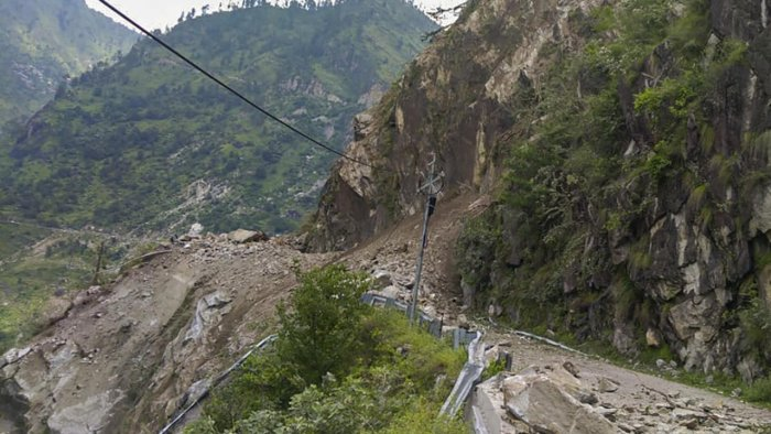 Many people feared to trap after a landslide occurred on the Reckong Peo-Shimla Highway in Kinnaur district, Wednesday, Aug 11, 2021. One truck and an HRTC bus reported came under the rubble. Indo-Tibetan Border Police (ITBP) teams rushed for rescue. Credit: PTI Photo