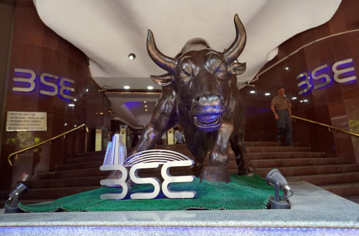 A man walks out of the Bombay Stock Exchange (BSE) building in Mumbai, India. Credit: Reuters/Hemanshi Kamani