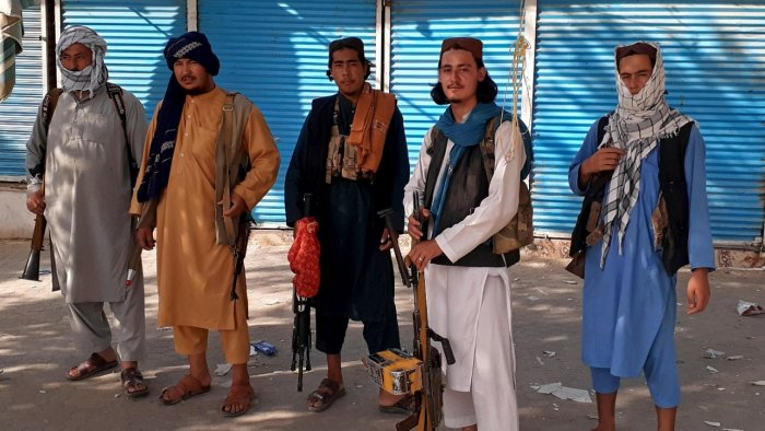 Taliban fighters stand guard in Kunduz city, northern Afghanistan. Credit: AP/PTI Photo
