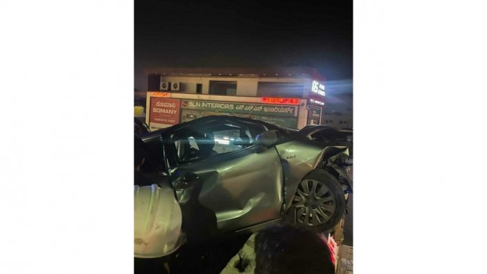 The car that hit the motorcycle and crashed into the side wall of the flyover on Hosur Road. Credit: DH Photo