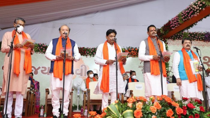 A total of 24 ministers, including two women, were sworn in by governor Acharya Devvrat in a function held at Raj Bhawan in Gandhinagar. Credit: Special Arrangement