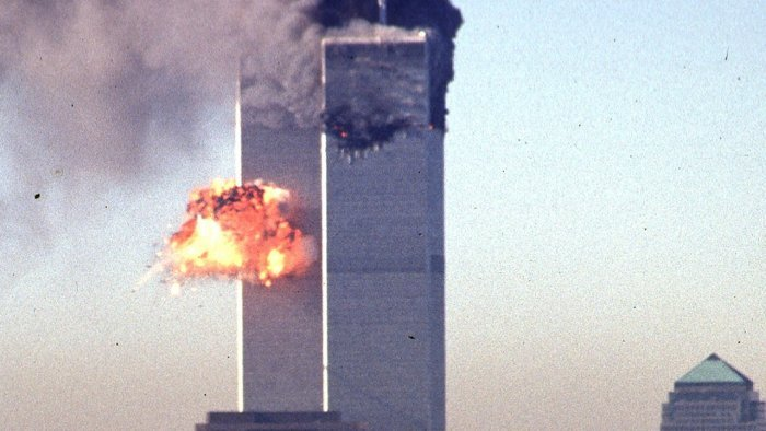 Smoke and flames erupt from the twin towers of the World Trade Center, after commercial aircraft were deliberately crashed into the buildings. Credit: AFP File photo