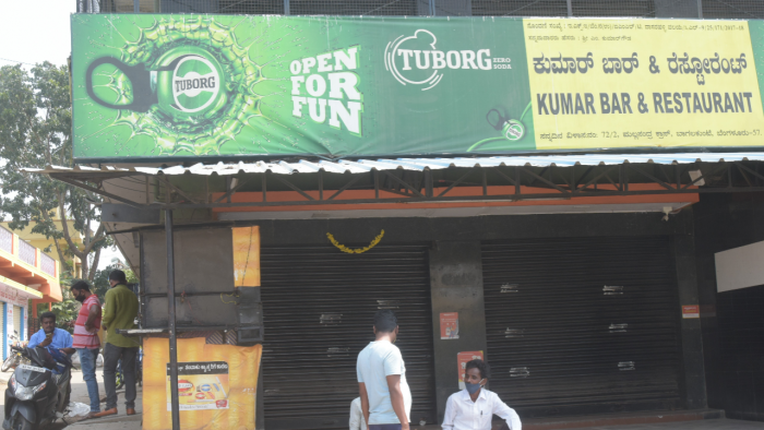 The ban was ordered to prevent Kerala tipplers from visiting Dakshina Kannada shops. Credit: DH Photo