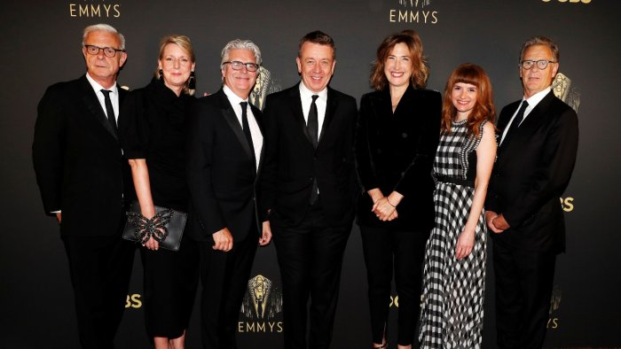 """Showrunner Peter Morgan, Director Jessica Hobbs, Executive Producers Stephen Daldry, Robert Fox, Matthew Byam Shaw and Suzanne Mackie, and Producer Oona O'Beirn, pose at the Netflix UK Primetime Emmy Red Carpet for """"The Crown"""" in London, Britain, September 19, 2021. Credit: Reuters Photo"""