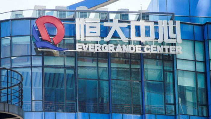 The logo of China Evergrande Group seen on the Evergrande Center in Shanghai, China September 22, 2021. Credit: Reuters photo