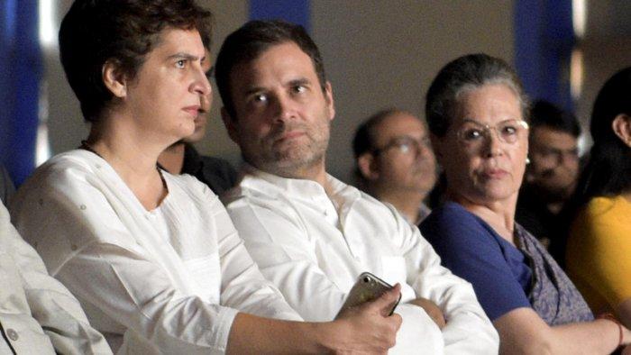 Priyanka Gandhi Vadra (L), Rahul Gandhi, and Sonia Gandhi (R). Credit: PTI File Photo